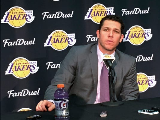 The Los Angeles Lakers' new coach, Luke Walton, takes question during a news conference in El Segundo, Calif., Tuesday, June 21, 2016. Walton knows he's got some catching up to do at his new job. Walton has finally arrived from Golden State, mere days before his downtrodden franchise adds its next big piece in the draft. (AP Photo/Greg Beacham)