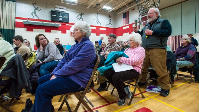 Michael Oman speaks in favor of a motion requiring presidential candidates to release their tax returns in order to appear on the Vermont primary ballot during Underhill's town meeting at the Browns River Middle School in Jericho on Tuesday, March 7, 2017. The motion failed.
