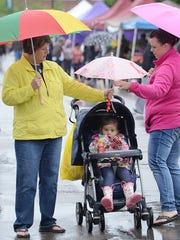 Ann Destarkey, left, helps manage umbrella coverage