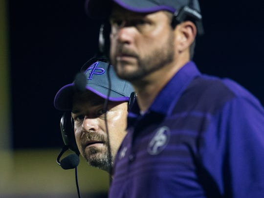 Aransas Pass's head coach Ryan Knostman looks out on to the field after a flag is thrown during the third quarter of their game against Taft at Ray Akins Wildcat Stadium on Friday, Sept. 15, 2017.