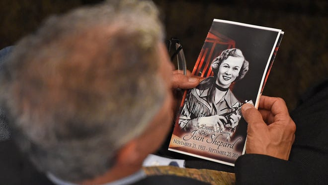 A funeral attendee looks over the program before funeral services for Jean Shepard, a Country Music Hall of Fame member, a member of the Grand Ole Opry for more than 60 years and one of traditional country musicÕs greatest advocates. Friday Sept. 30, 2016, in Hendersonville, Tenn.