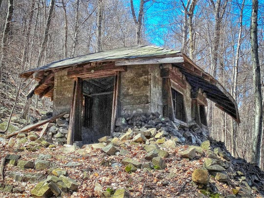 This abandoned building has similar characteristics as some of the other park buildings along the trail in Hook Mountain State Park.