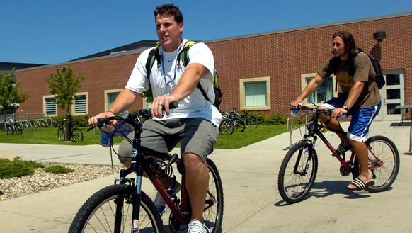 Vikings linebacker Chad Greenway, left, a Mount Vernon