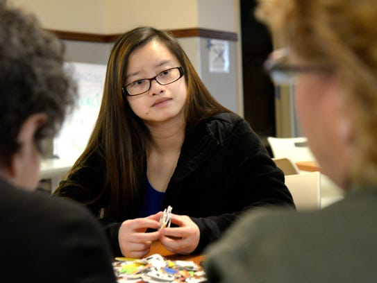 Silver Lake College student Hnubci Yang works on a