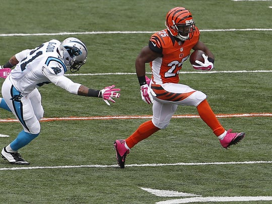 Cincinnati Bengals running back Giovani Bernard (25) gets by Carolina Panthers free safety Thomas DeCoud (21) to score a 89 yard touchdown during the second quarter of their game played at Paul Brown Stadium.