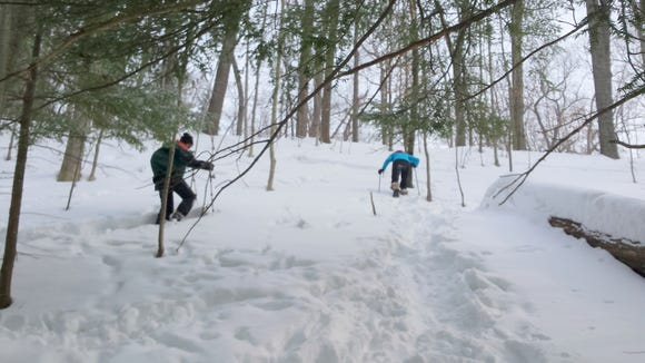 Snowshoeing uphill is one way to show you're healthy.