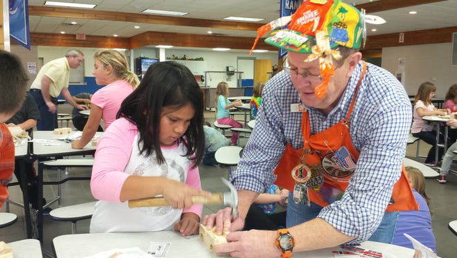 Destinee Hernandez works with Home Depot employee Rob CharlierAnglim.    Second grade students at Random Lake Elementary School recently participated in a free kid's workshop offered by Home Depot.