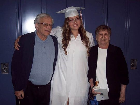 Emily Litolff, center, with her grandfather Robert