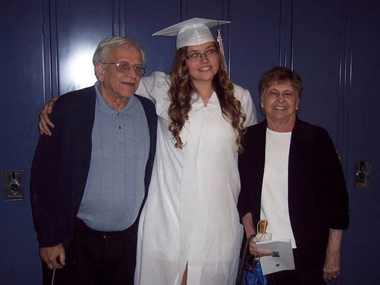 Emily Litolff, center, with her grandfather Robert Litolff and grandmother Jane Litolff.