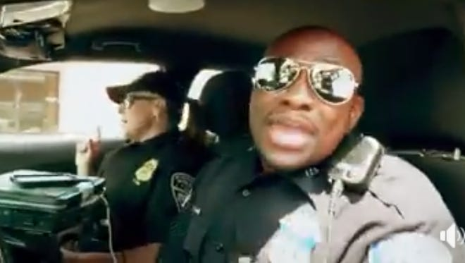 """Evansville Police Department officers lip-sync to the classic hit """"Ain't No Mountain"""" in a Facebook video has has gone viral Friday evening."""
