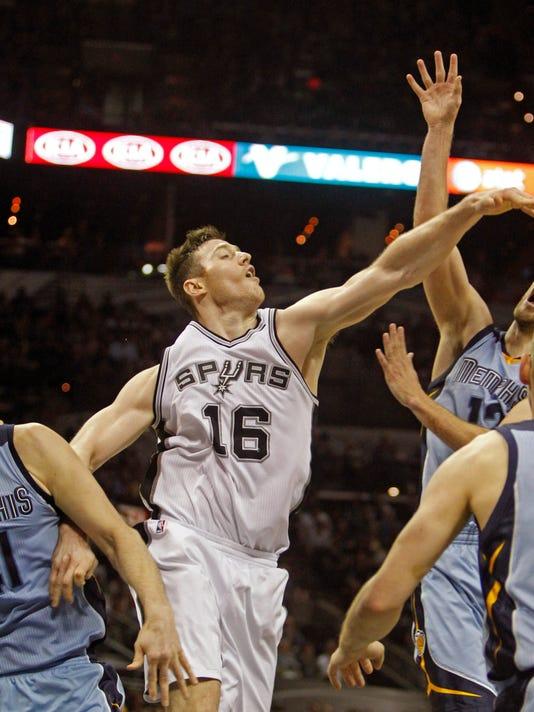 635719572481690620-AP-Grizzlies-Spurs-Basketbal