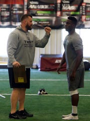 Director of Football Operations, Geir Gudmundsen speaks with Columbia senior Oluwatoba Akinleye during an NFL-style workout at TEST Sports in Martinsville.  April 19, 2016. Martinsville, N.J.