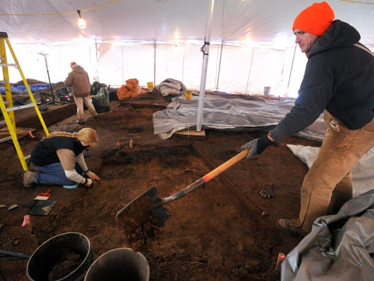 Archaeology volunteers excavate the site of a small