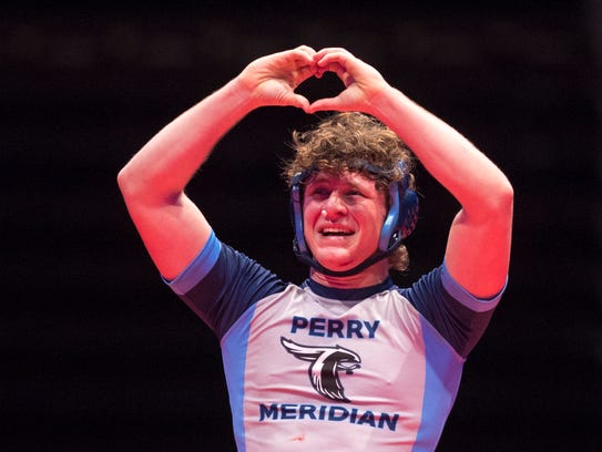 Perry Meridian's Noah Warren celebrates his defeat