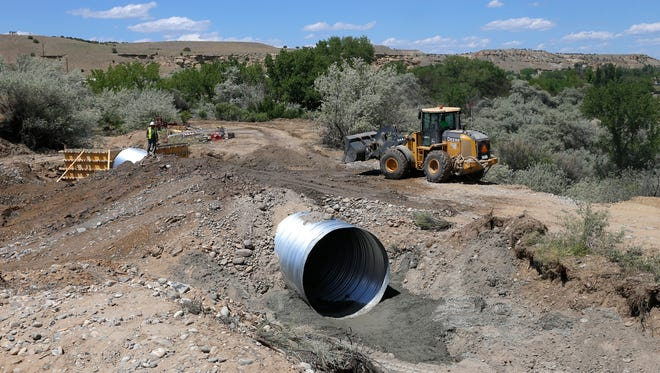 Repair work continues on Monday at the Bloomfield Irrigation Ditch in Blanco.