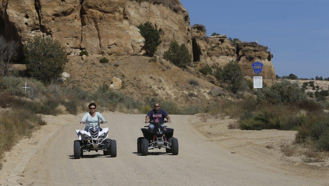 In a file photo from Oct. 8, 2015, Robert and Teri McCune ride their ATV in the Glade Run Recreation Area in Farmington.