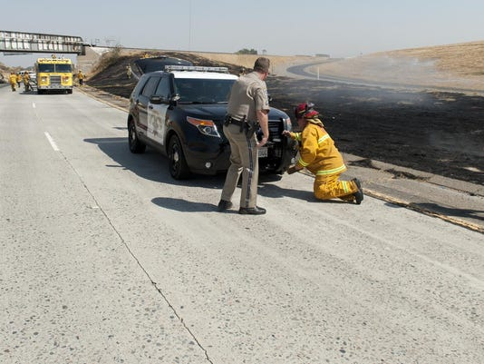 CHP car triggers fire on Hwy  198