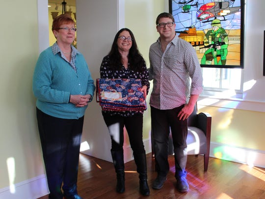 Bosworth, left, presents a Quilts Of Valor quilt to Kim Brown and Nick Leonetti from the Atlantic County Veterans Museum.