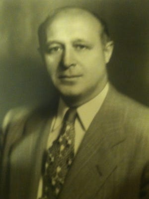 The family of Joseph James Novack, who served as city clerk for decades, wants Garfield to honor him.