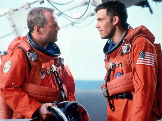 """Training to shuttle into space to plant nuclear explosives in an asteroid that threatens to destroy the Earth, Harry S. Stamper (Bruce Willis) and A.J. Frost (Ben Afflect, right) prepare for the toughest challenge ever faced by mankind in Touchstone Pictures' action film """"Armageddon"""" from producer Jerry Bruckheimer."""