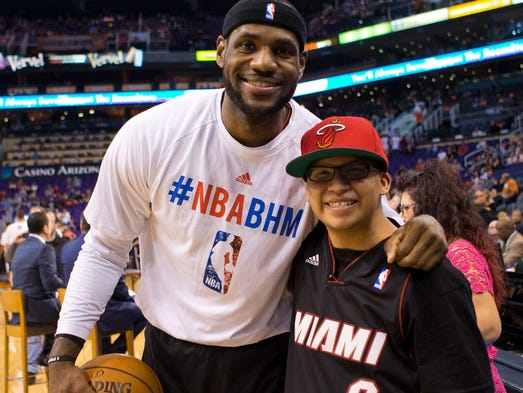 Deer Valley High School special-needs student Jose Meraz meets LeBron James before a game against the Suns at U.S. Airways Center on Feb. 11, 2014.