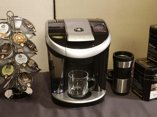 Keurig's Green Mountain Coffee Roasters Vue individual coffee roasting system, which can also prepare frothy hot beverages and iced drinks, is displayed during a news conference in New York, Wednesday, Feb. 15, 2012.