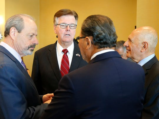 Mayor Oscar Leeser, left, Lt. Gov. Dan Patrick, second from left, Greater El Paso Chamber of Commerce President Richard Dayoub, right, and state Rep. José Rodríguez speak before Patrick's speech at a luncheon Thursday at the DoubleTree hotel about his top priorities during the upcoming 85th legislative session.