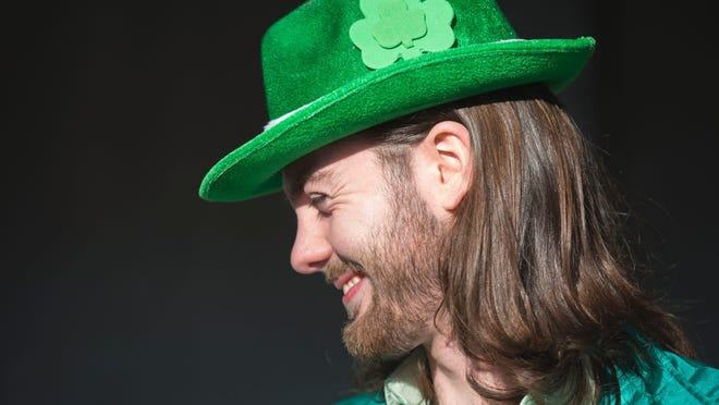 Chris Leising, 22, celebrates Green Beer Day at the Brick Street in downtown Oxford with friends. The annual Green Beer Day started at Miami University in 1952. It's celebrated the day before the start of Miami University's Spring Break. Leasing is a nursing student from the University of Cincinnati.