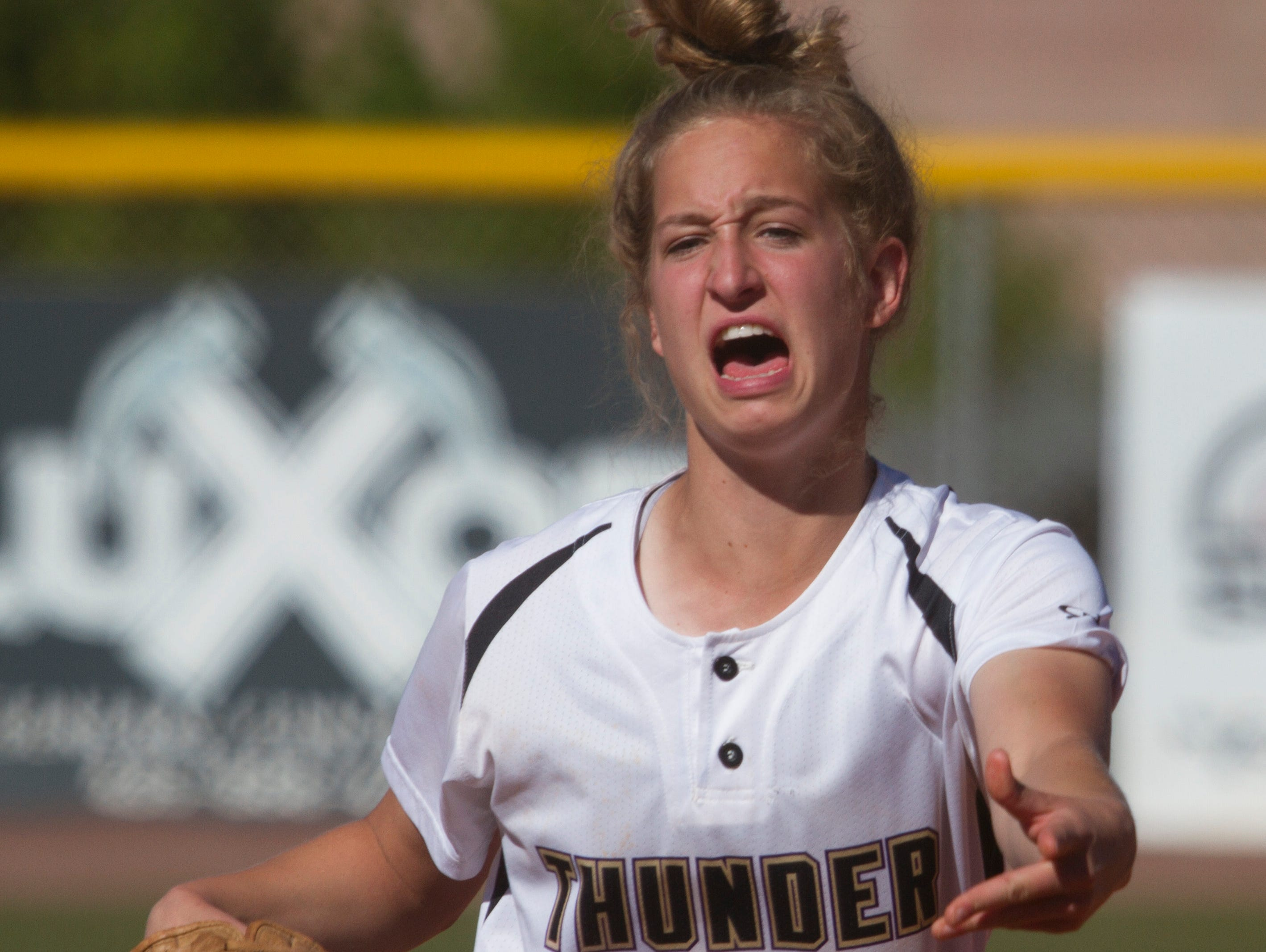 Desert Hills pitcher Brianna St Clair leads off their game against Dixie High Friday, April 1, 2016.