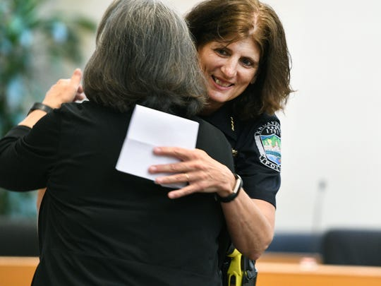 Eve Thomas hugs Mayor Madeline Rogero after being named Knoxville's new chief of police Thursday, June 21, 2018.