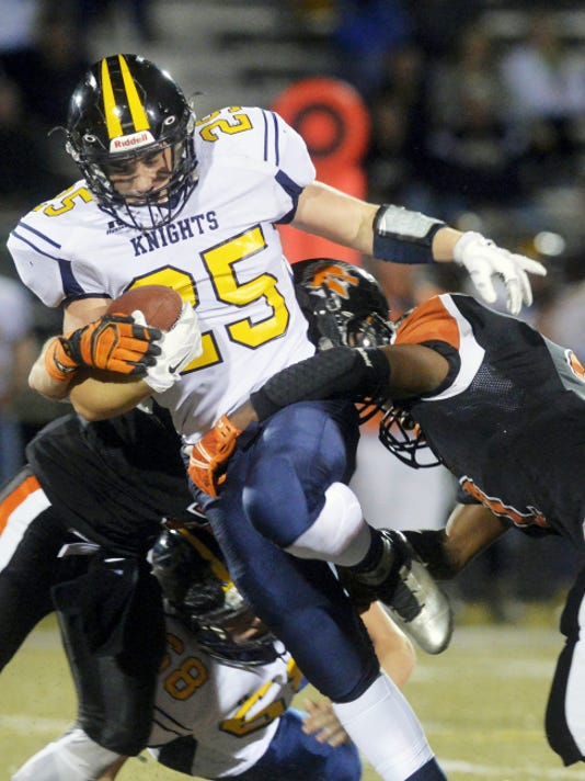 Eastern York's Brennen Shenk gets caught up in the York Suburban defense in the second half of a YAIAA football game Friday, Nov. 6, 2015, at York Suburban. York Suburban defeated Eastern York 30-7.