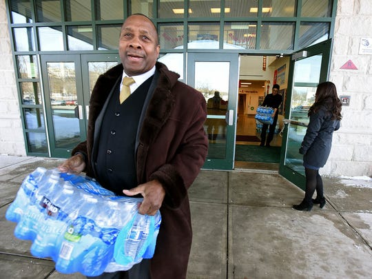 Roy Cox  carries water donated by Grieco School students  to  Englewood Hospital in response to contamination found at the hospital. Photographed February 10, 2017.