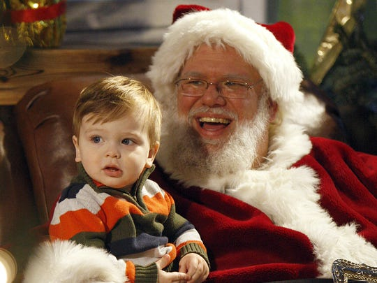 9,793 photos taken with Santa in 2011  Jacob Cyran, 14 months, of Anderson Township, sits on Santa's lap during the Cincinnati Zoo's 29th Annual PNC Festival of Lights. / The Enquirer/ Amanda Davidson