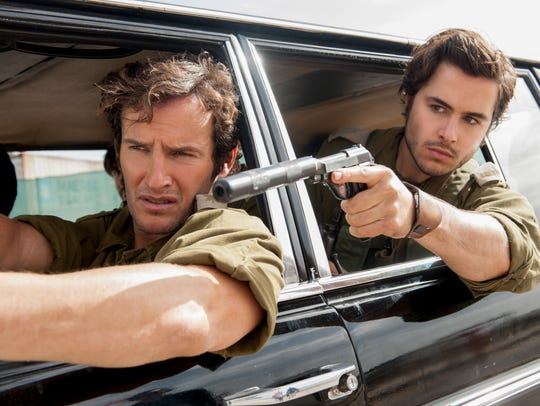 "Angel Bonanni (left) and Ben Schnetzer star in ""7 Days in Entebbe."""