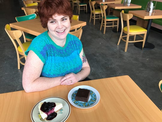 Love Handle co-owner and pastry chef Ally Benedyk and her classic brownie and blueberry. cheesecake. The Indianapolis restaurant is on Mass Ave.