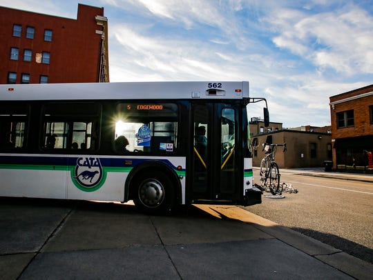A CATA bus pulls out of the downtown CATA station Friday,
