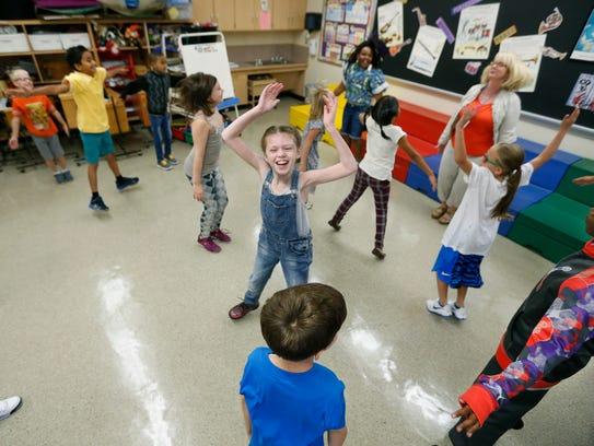 Third-grader Clover Lapoma enjoys some exercises to