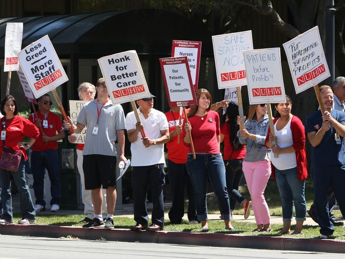 Salinas Valley Memorial Hospital nurses, other employees and community members picket Thursday in front of the hospital. SVMH has proposed cuts count affect patient care, according to the California Nurses Association.