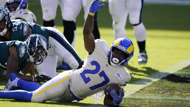 Los Angeles Rams' Darrell Henderson reacts after scoring a touchdown during the second half against the Philadelphia Eagles on Sunday. He should get more work after leading the backfield in touches and yards in Week 2.