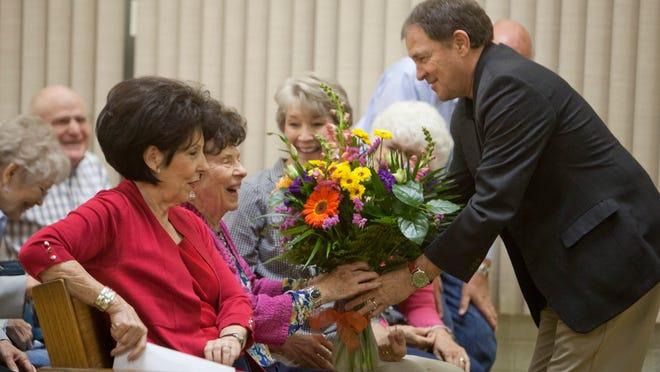 Gov. Gary Herbert greets Founders Day honoree Ardella Gubler Heiner on Saturday, April 25, 2015.