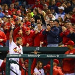 St. Louis Cardinals starting pitcher Adam Wainwright takes a curtain call after hitting a three-run home run off of Philadelphia Phillies starting pitcher Jeremy Hellickson during the fourth inning at Busch Stadium in St. Louis Monday.