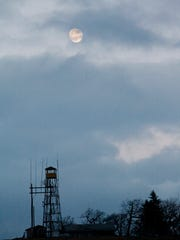 The moon rises over the fire tower on Bearwallow Mountain