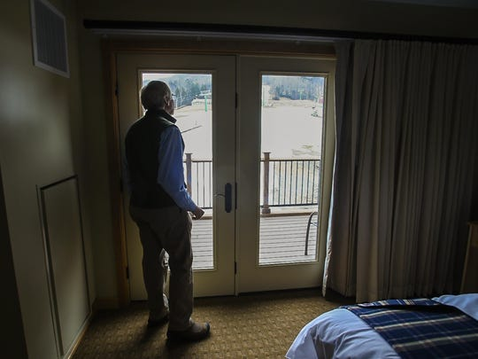 Developer Bill Stenger looks out at the Burke Mountain ski area from an unused hotel room at the Q Burke Restort in East Burke on Thursday, March 10, 2016.