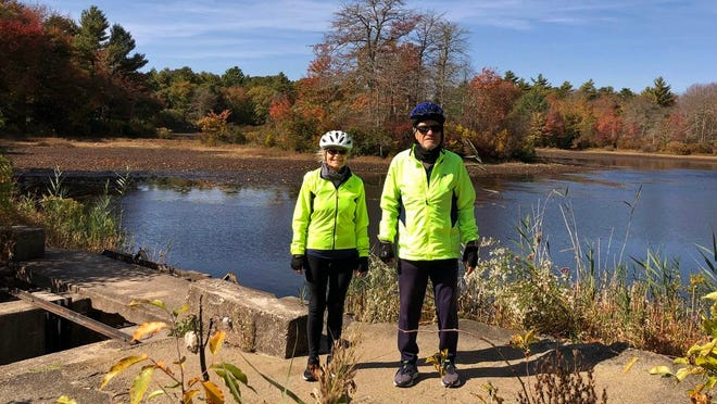 Louise and Paul Anthony of Mattapoisett at the site of the former Tripp Mill on Tinkham Pond near their home. The water level is low for mid-October.