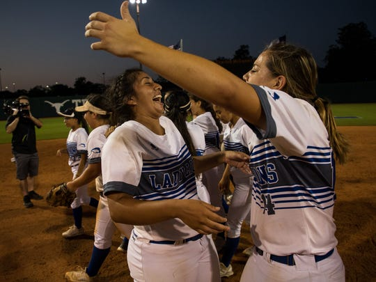 Santa Gertrudis's Saidi Castillo and Kennedy Silva  celebrates winning the 3A state championship game against Hughes Springs at McCombs Field in Austin on Thursday, May 31, 2018.