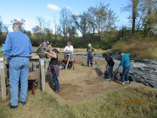 Swannanoa Valley Museum docents take turns digging for projectile points and pot sherds at Fort San Juan in Burke County.