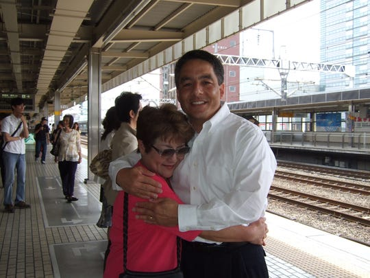 Bruce Hollywood, right, poses for a photo with his mother, Nobue Ouchi, in 2009 a month before she passed away.