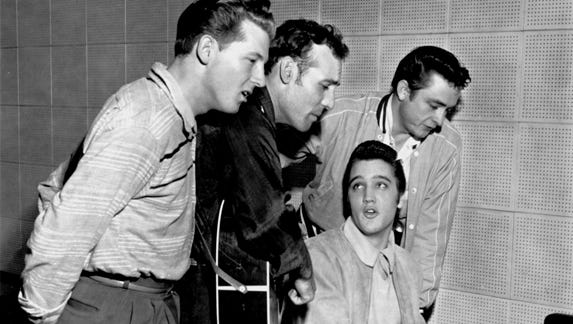 The only thing predictable about Elvis is that he's unpredictable. On Dec. 4, 1956, Carl Perkins, second from left, was cutting some new records at Sam Phillips' Sun Records studio on Union at Marshall. Elvis Presley dropped in. So did Johnny Cash, right. Jerry Lee Lewis, left, was already there. Elvis headed for the piano, and an old-fashioned barrelhouse session with barbershop harmony resulted. Accompanying Elvis was his houseguest Marilyn Evans, not pictured, 19, a dancer at the New Frontier in Las Vegas.