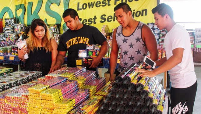In this file photo, Cassandra Dixon, Jessi Trujillo, Santiago Trujillo and Andy Trujillo shop for fireworks at Amy's Fireworks on U.S. Highway 70 in 2016.