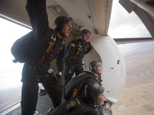 Members of the U.S. Army Golden Knights, watch for wind indicators before their opening jump as part of the Thunder Over Utah air show Saturday, July 26, 2014.